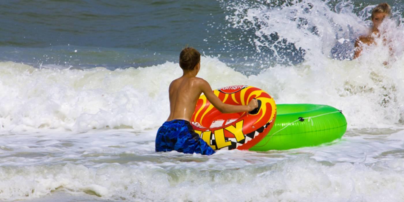 kids playing in the ocean in Kill Devil Hills